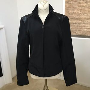 Sleek style black jacket with leather trimming